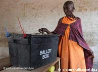 A Kenyan woman posting her vote in the ballot box
