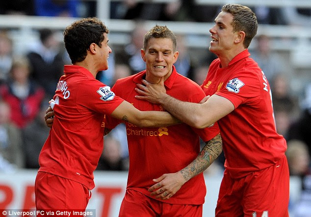 On the way: Daniel Agger (centre) scored early to put Liverpool on the way to a comfortable victory