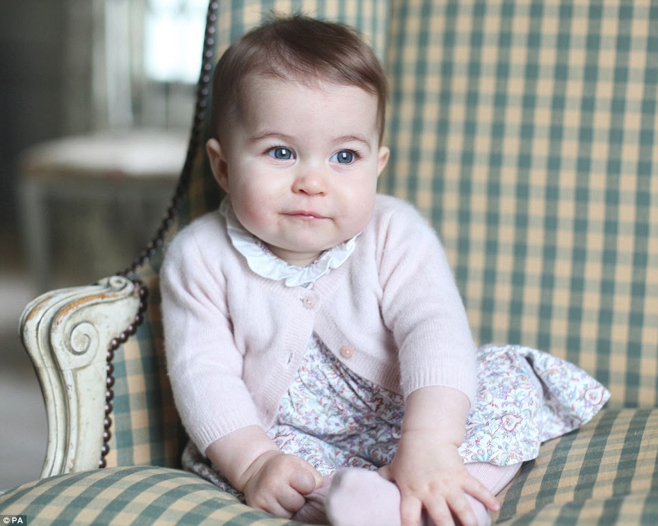 Princess Charlotte is wearing a floral print dress with a white frilled collar, the designer of which was not released by Kensington Palace.This is coordinated with pale pink wool tights and a pink cardigan on top
