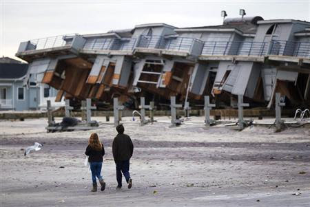 People walk past a beach club destroyed by Hurricane Sandy in Sea Bright, New Jersey, October 31, 2012. (Credit: Reuters/Lucas Jackson) Click to enlarge.