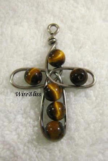 wire cross with tiger eyes