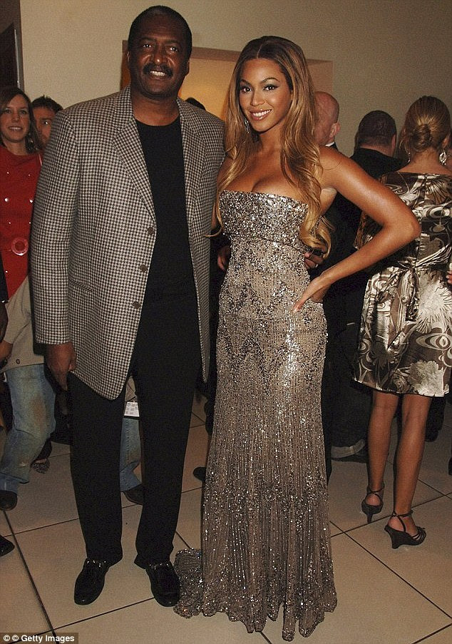 Making ends meet: Mathew Knowles held a yard sale over the weekend to sell his oldest daughter Beyonce's memorabilia, according to TMZ; here he is pictured with the Crazy In Love singer in 2007