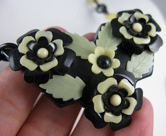 black cream floral bakelite necklace center