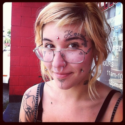 Knowledge Face Tattoo For Girls