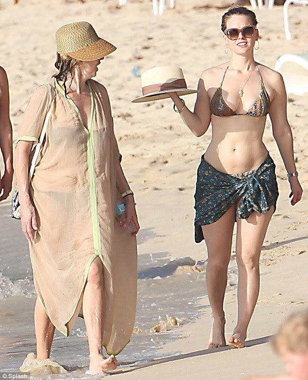 Seeing double: And proving the apple certainly doesn't fall far from the tree, Sharon looked utterly showstopping in a dramatic nude kaftan and straw hat as she soaked up the Caribbean sun