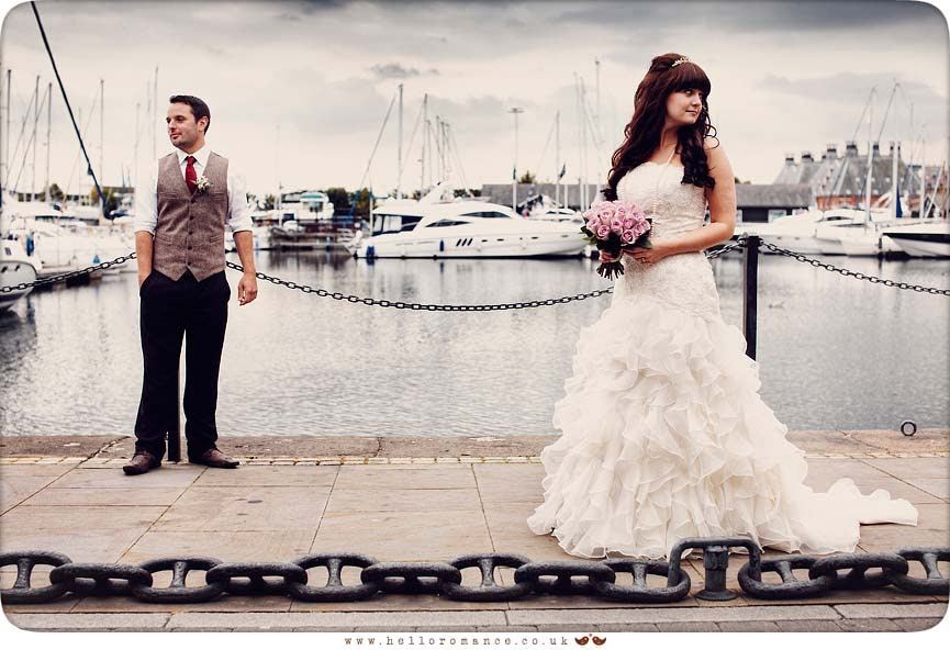 Bride ang Groom posing, boats and waterfront at Isaac Lord Ipswich Waterfront Isaac's Suffolk Unique Vintage wedding photography - Hello Romance Wedding Photography