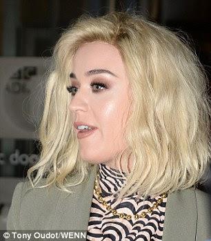 Upbeat: Katy estava em espírito alto como ela saudou seus fãs adorando na terça-feira