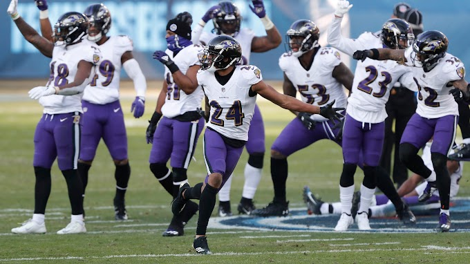 Ravens defense celebrates Marcus Peters' game-sealing interception by dancing, stomping Titans logo