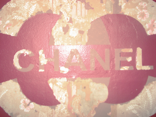 reverattraperr: this is what happened when i took off my chanel decal. three different layers of wallpaper, and i kind of like it.