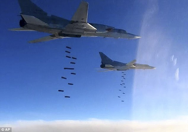 The Russian defense ministry has said its warplanes have flown their first combat mission in Syria with US-led coalition aircraft. Pictured are two Russian Tu-22M3 bombers on Monday