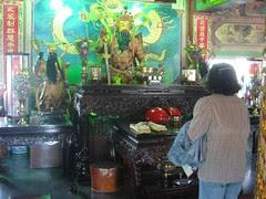 a taiwanese woman worshiping