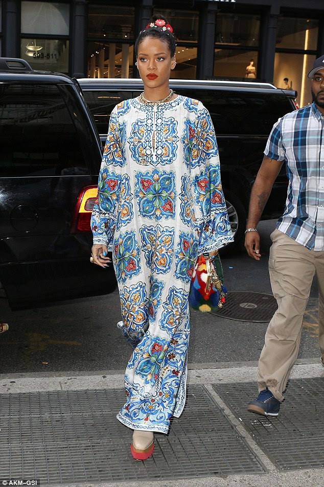 Unique outfit: Rihanna emerged for some shopping and then dinner in NYC on Sunday while wearing an eye-catching blue embellished kaftan dress