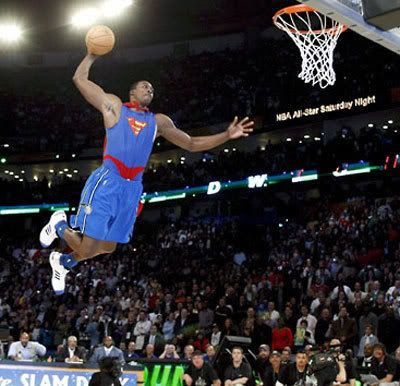 Dressed up like Superman, Dwight Howard makes one of many spectacular dunks that would lead to him winning the 2008 Slam Dunk Contest.
