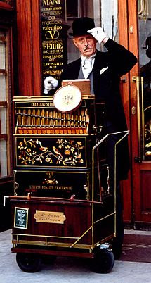 Barrel organ player in Vienna, Austria. Photo by Andrzej Barabasz (Chepry) (2002), via Wikipedia, used w/o permission.