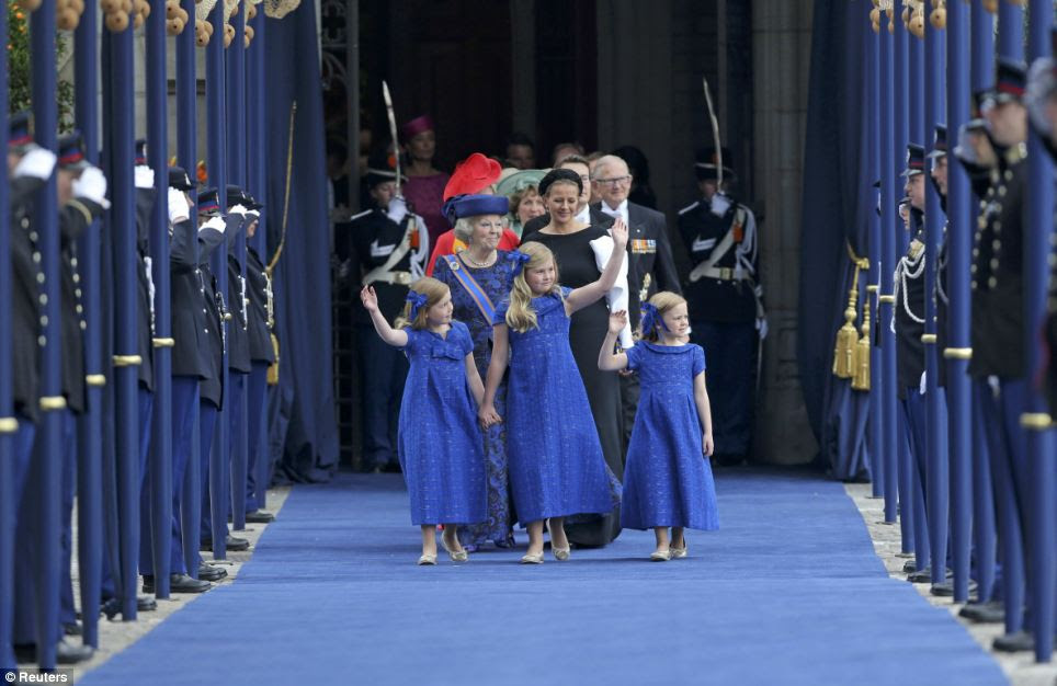 Little princesses: The three young girls dressed in blue wave to the crowds