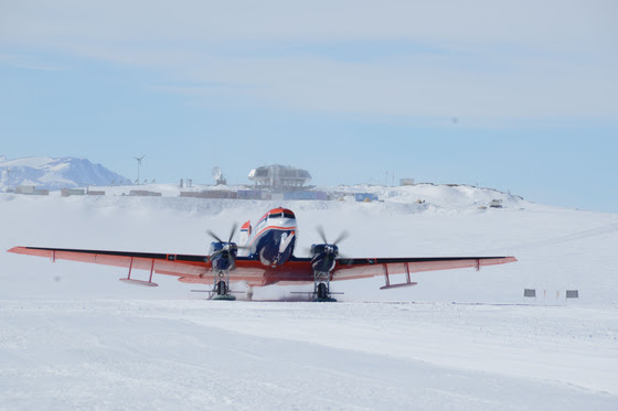 AWI's Polar 6 aircraft takes off from the runway at the Princess Elisabeth Antarctica research station. © International Polar Foundation / Jos Van Hemelrijck