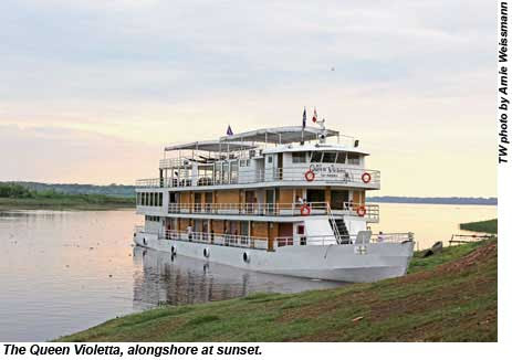 The Queen Violetta, alongshore at sunset.