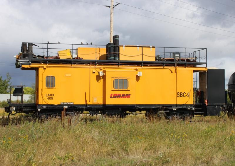 Caboose SBC-9 with Loram ballast cleaner in Winnipeg