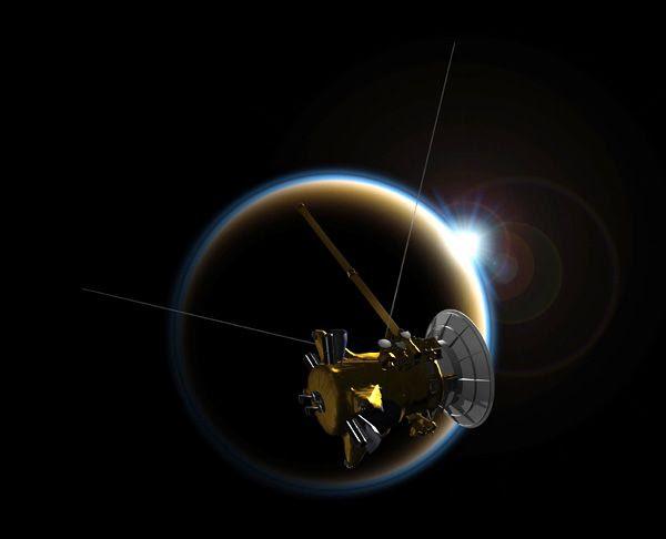 An artist's concept depicting NASA's Cassini spacecraft flying past Saturn's moon Titan.
