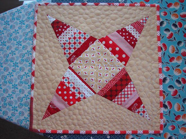 Candy Cane Table Topper - Start getting ready for the holiday season with a gorgeous quilted table topper pattern. Add holiday fabric in strips to make a modern Christmas quilt pattern that's going to make your table pop.