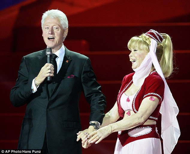Her new master: Eden then reenacted her classic wish-conjuring arm and head nod, which magically brought out her new 'Master' - former US President Bill Clinton