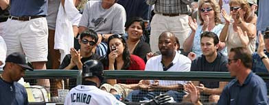 Fans cheer as Ichiro Suzuki #51 of the Seattle Mariners goes back to the dugout during the game against the Detroit Tigers on July 15, 2007 at Safeco Field in Seattle, Washington. The Tigers won 11-7. (Photo by Otto Greule Jr/Getty Images)