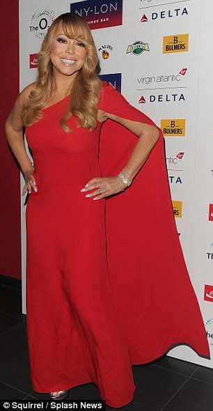 Birthday girl: Stylist Wilfredo Rosado put the pop diva - who turns 46 this Sunday - in a single-sleeved red caped gown and silver peep-toe platforms