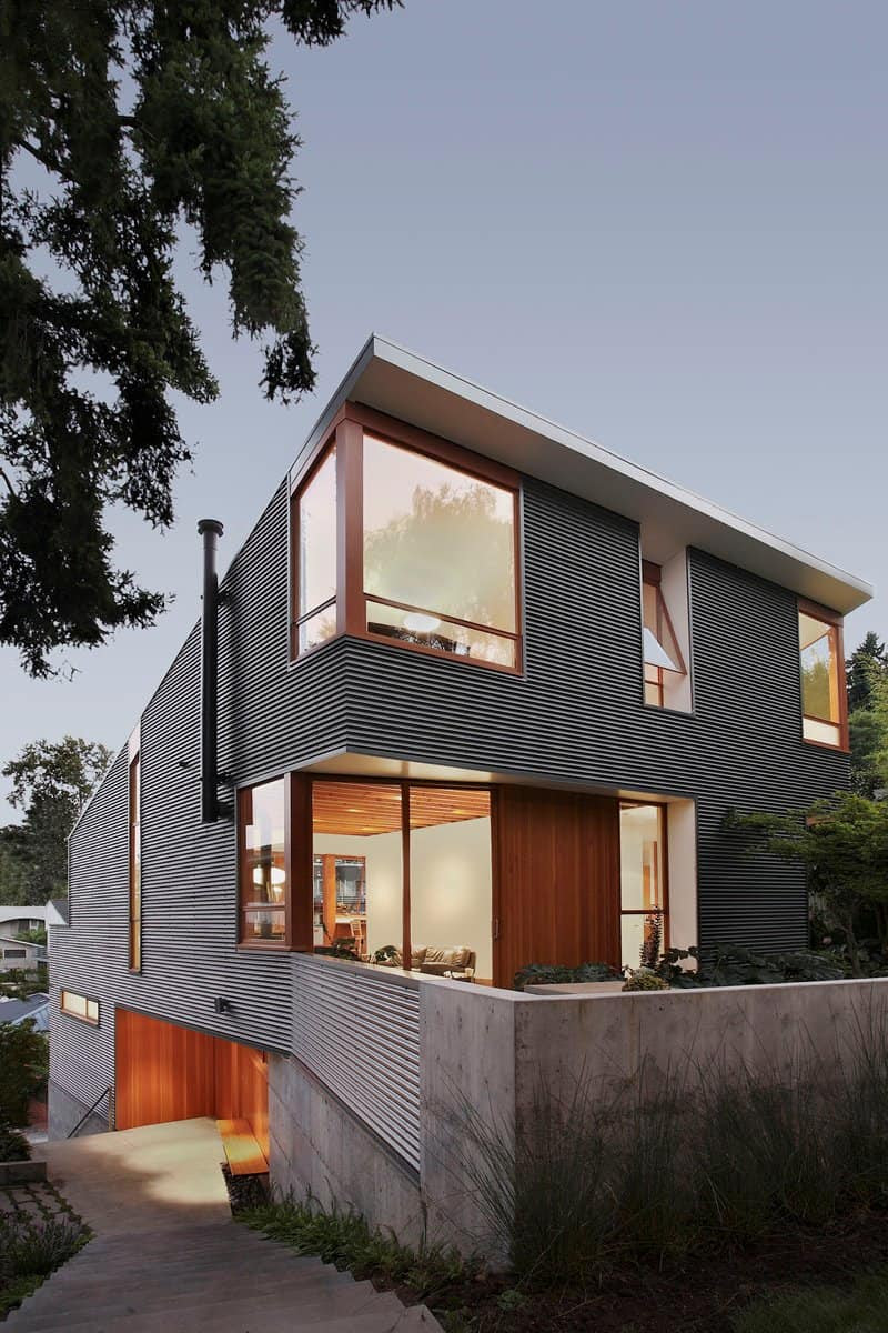 Corrugated Steel House with Warm Wood Details Throughout ...