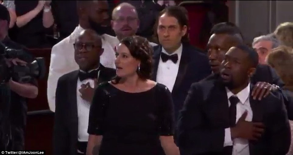 The group was still confused as they headed to the stage to accept their surprise award
