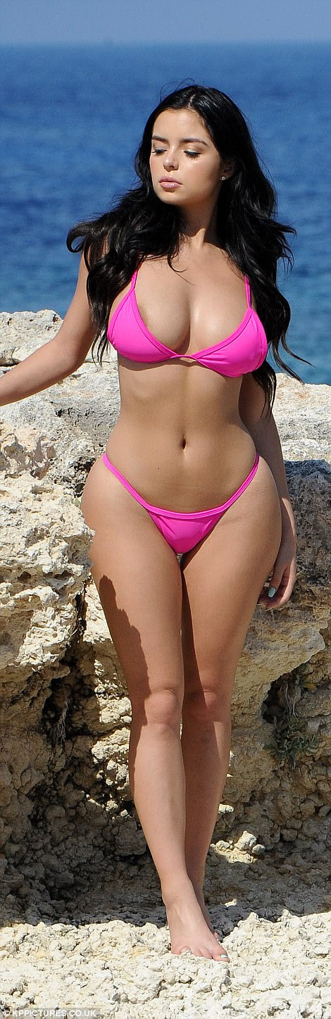 Hourglass: Pulling her thong bikini bottoms high over her curvaceous hips in a 90s style favoured by supermodels such as Bella Hadid, the beauty emphasised her impossibly tiny waist and shapely hips