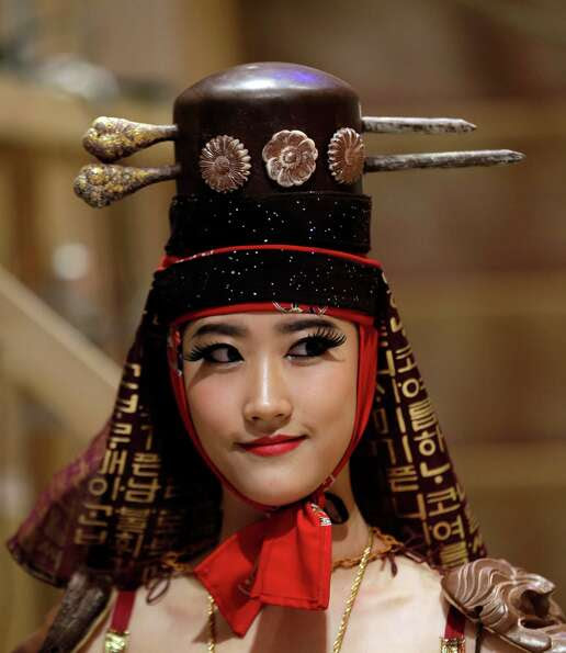 A model displays a traditional Korean outfit partially made of chocolate during chocolate fashion sh
