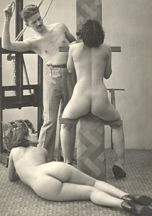 Shirtless man whipping two nude women
