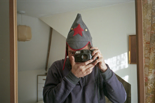 reflected self-portrait with Kenox FX-4 camera and pointy hat by pho-Tony