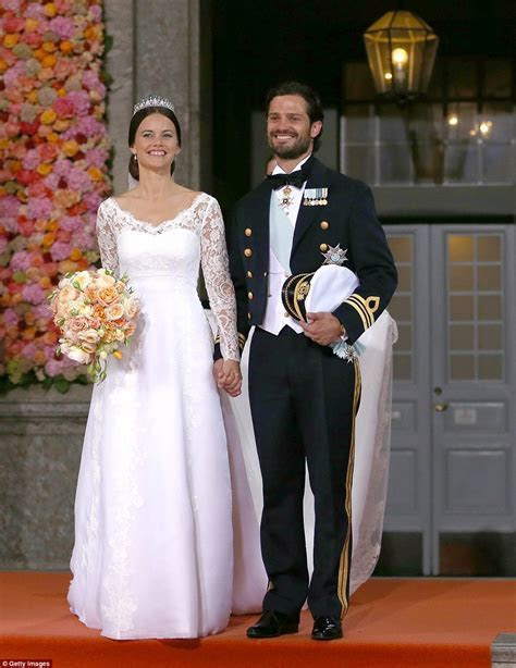 Display of couture wedding gowns worn by Swedish royals to