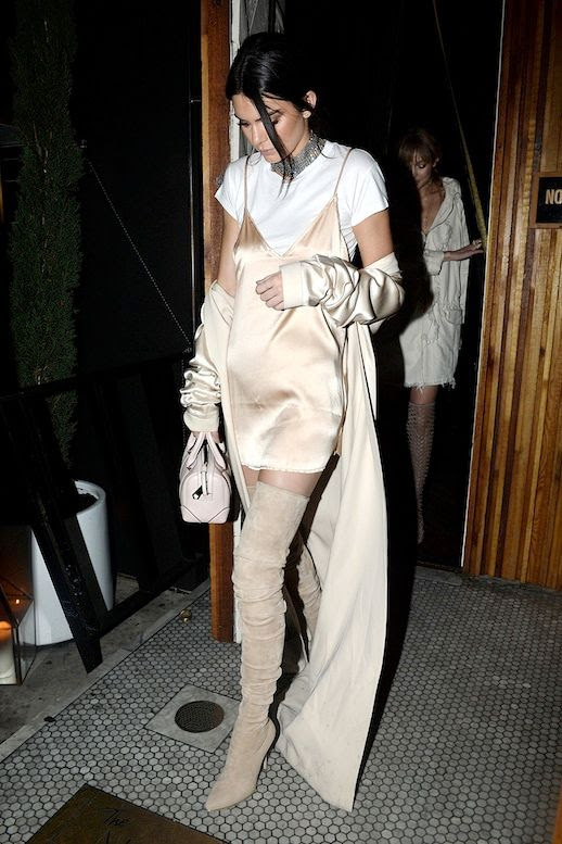 Le Fashion Blog Street Style Kendall Jenner Sexy Layered Neutral Look Metal Mesh Choker Blush Silk Dress White Tee Cream Duster Coat Pale Pink Mini Bag Suede Over The Knee Boots Via Harpers Bazaar