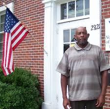 Veteran standing in front of housing