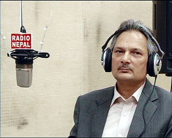 English: PM Bhattarai during a live talk show.
