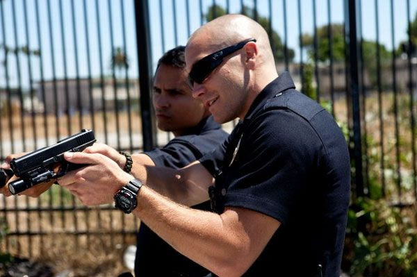 Jake Gyllenhaal and Michael Peña in END OF WATCH.