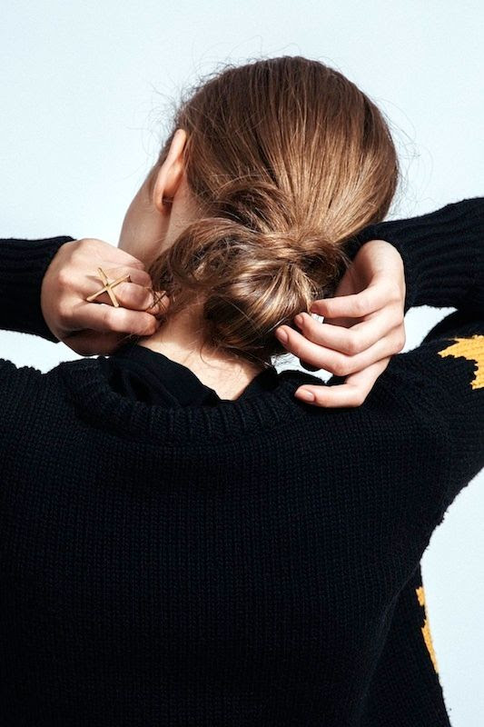 Le Fashion Blog 5 Easy Hairstyles For When You're Running Late Lazy Girl Hair Loose Bun Black Sweater Cross Midi Rings Via Refinery29