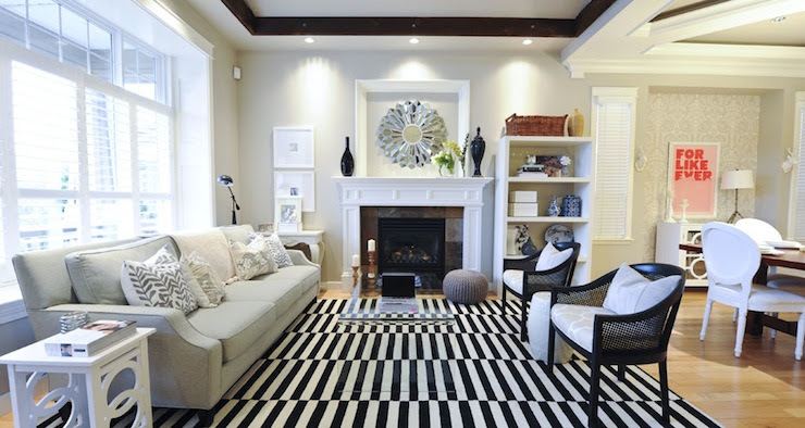 Suzie: Andrea Johnson Design  Beautiful open living room with gray walls paint color, tray ...