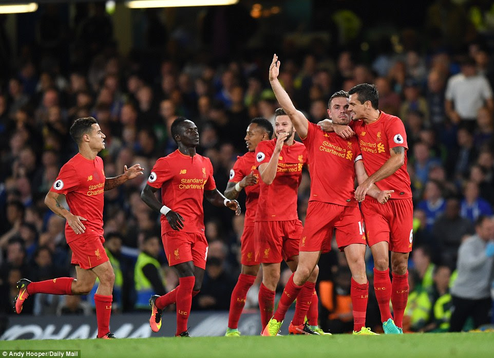 Liverpool players celebrate Jordan Henderson's stunning strike that earned a 2-1 victory over Chelsea