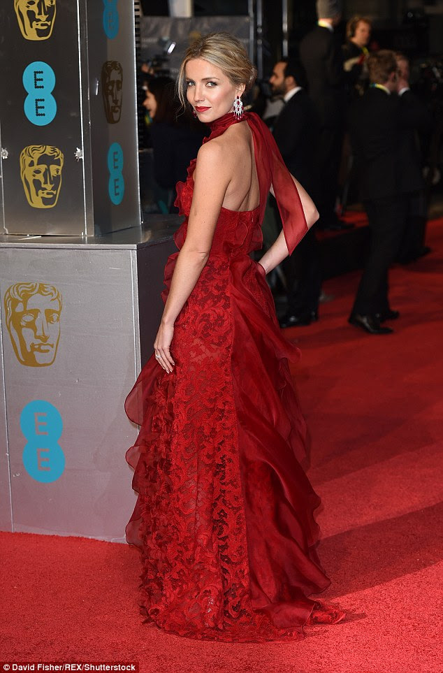 Dramatic: The Peaky Blinders star showed off the stunning back detail of her dress, with its ruffled skirt and halter-neck detail