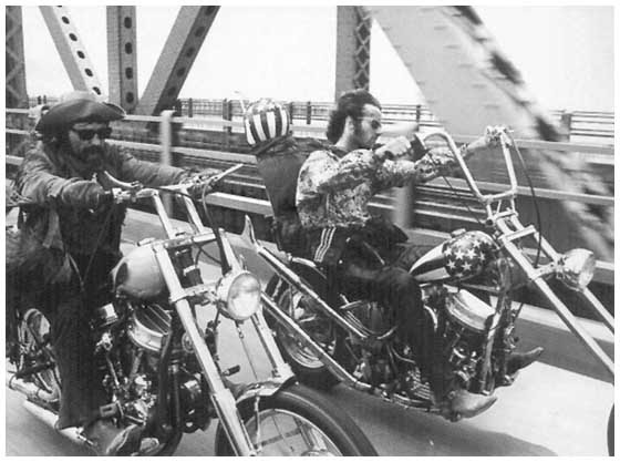 B & W photo of Peter and Dennis (Wyatt and Billy in the film) riding over a bridge side by side