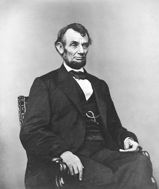 Archivo:Abraham Lincoln seated, Feb 9, 1864.jpg