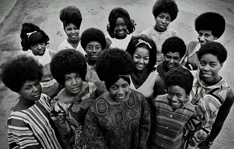 "Description of  JUL 2 1969 - Contestants Vie for title of ""Miss Black Denver"" in Pageant Set Friday at Manual High School. From left, front row, are Julia Sistrunk, 18; Kathy Abernathy, 19; Doris Thomas, 21; Judy Benton, 17; center row, Sondra Francis, 20; Florence Ayres, 22; Sherri Baucom, 22; Mary Gilmore, 18; Doris Boyd, 17. Back row, Melodene Alexander, 17; Beverly Flentroy, 22; Joyce Canaday, 19, and Billye Coleman, 20. Parade will start two-day fete. (Don Goodwin/The Denver Post)"