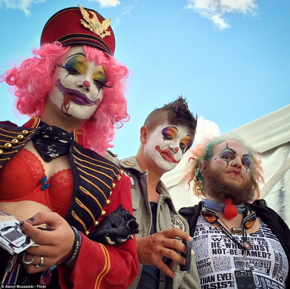 Clown posse: This group's eclectic attire is given a common theme, while one of them dons a Harry Potter vest (right)