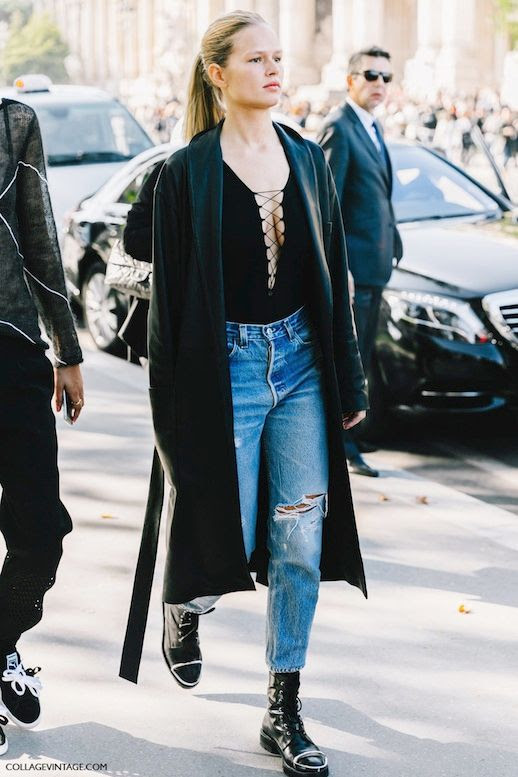 Le Fashion Blog Fall Street Style Pfw Anna Ewers Blonde Ponytail Long Black Coat Plunging Lace Up Top Distressed Denim Metal Cap Toe Leather Combat Boots Via Collage Vintage