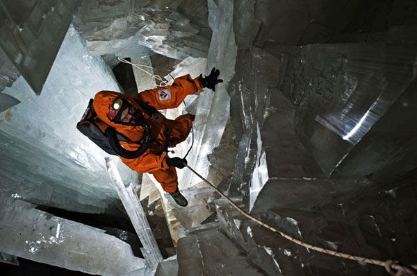 Clad in a protective ice-cooled jumpsuit, a researcher rappels his way into the Cave of Crystals...whose interior can get as hot as 112°F.