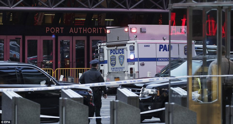 An NYPD van parked outside the Port Authority entrance at 8th Avenue and 41st Street on Monday morning