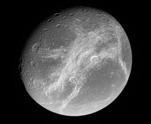 "Dione's trailing hemisphere, showing the patches of ""whispy terrain"". Credit: NASA/JPL"